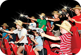 Kids enjoying interactive fun attraction shoot'em up cinema